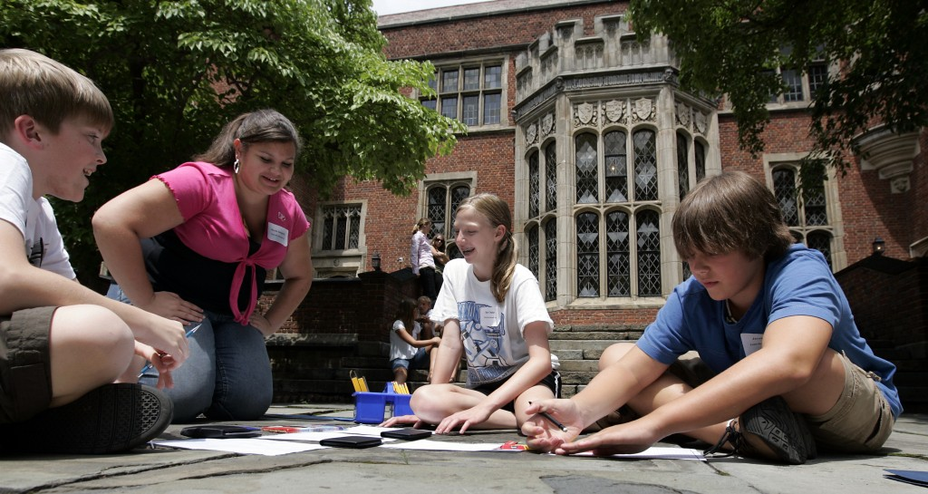 Middle school students work on a project in the Center's back yard.